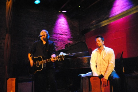 Dynamo performer Llanas (left) belts-it-out at the Rockwood Music Hall, NYC, Sept. 2012.  Accompanied by long-time percussionist Ryan Schiedermayer (right).  Photo by Lynn Vala