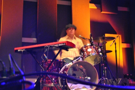 Drummers are always the hardest to photograph.  Especially when they wear stylin' hats!  Photo by Lynn Vala