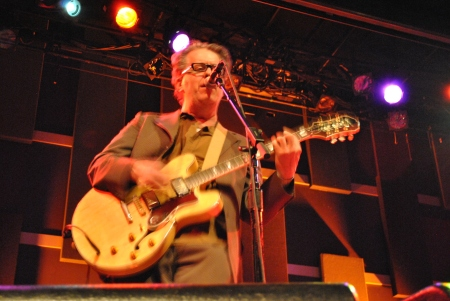 Mark Mulcahy wails on his trusty Epiphone.  Settle in for some amazing songs, stories and smiles.  Photo by Lynn Vala